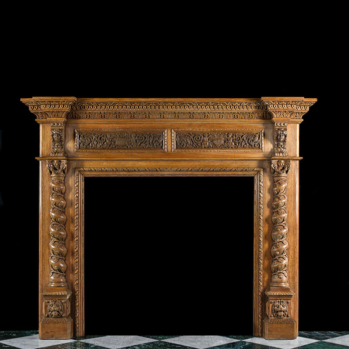 A Renaissance Style Light Oak Fireplace