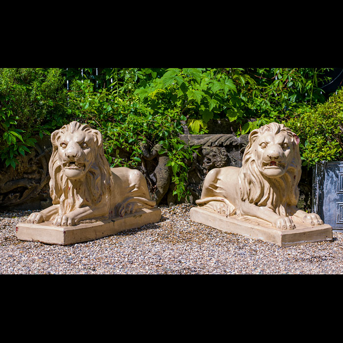 10884: A pair of large Bristol glazed recumbent lions. English,  19th century.  Link to: Antique fountains, sculptures, garden furniture and statuary