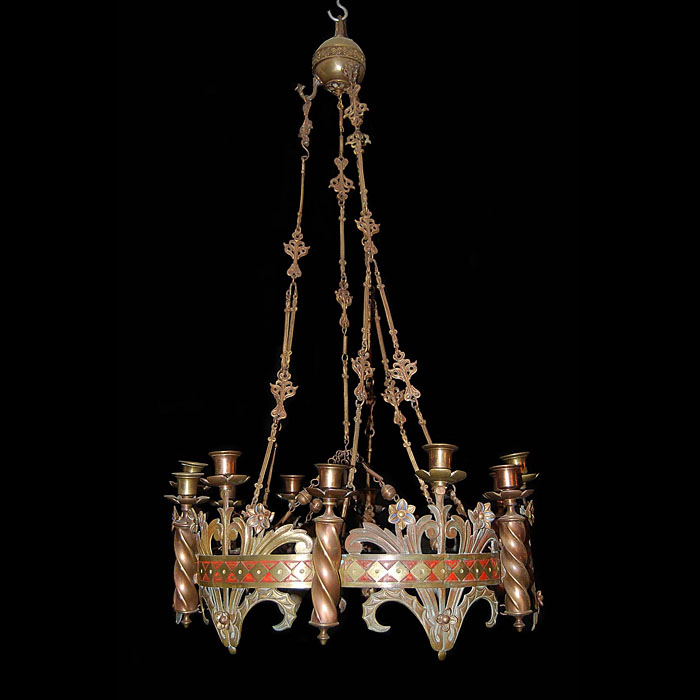 An antique Gothic Revival eight light brass chandelier