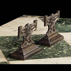Antique pair of cast iron Greek Revival style fie dogs