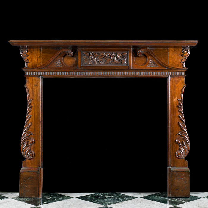 A Walnut Palladian Style Fireplace Mantel