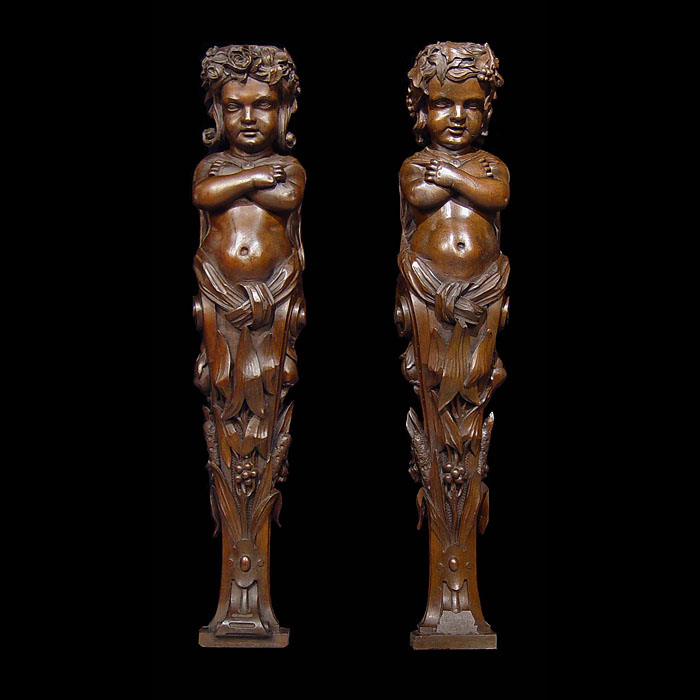 A pair of antique Italian carved walnut caryatid
