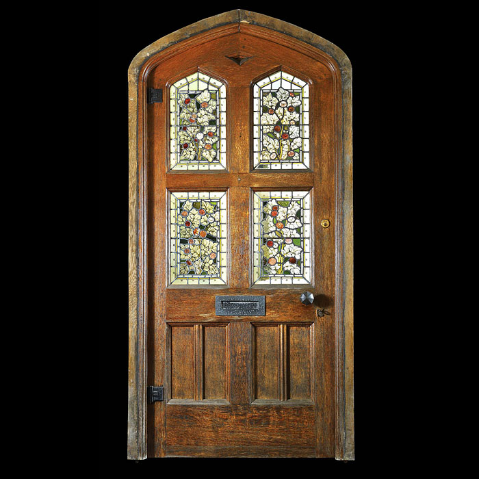 Gothic Revival carved oak stained glass door.