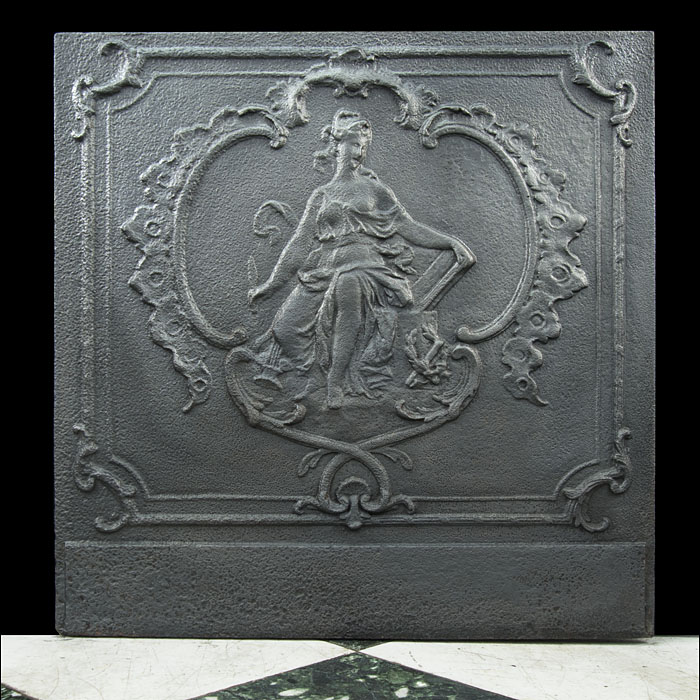 A 19th century cast iron fireback