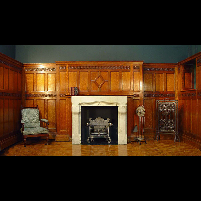 Antique Panelled Oak Arts and Crafts Room with an ornate frieze