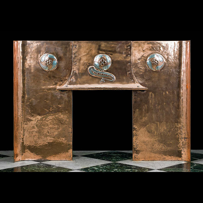 A Copper and Pewter Arts and Crafts wide Fireplace Insert