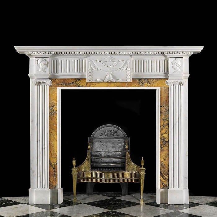 11116: A carved Georgian Neo Classical chimneypiece in statuary marble with Siena marble ingrounds.The large center tablet carved with a floral urn, and bellflower pendants flanked byfluted frieze panels and