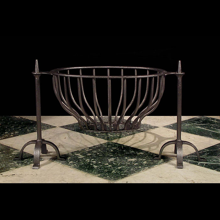 A Wrought Iron Victorian Oval Fire Basket