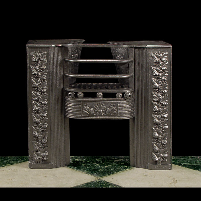 11123: A small cast iron hob grate with high relief cast ivy saide panels.  Link to: Antique Hobgrates