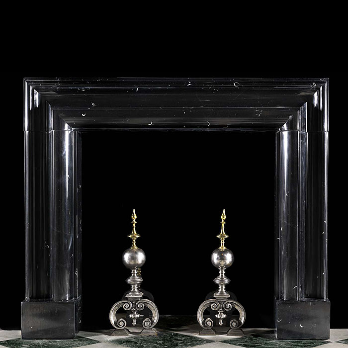 A 20th century black Kilkenny Marble fireplace