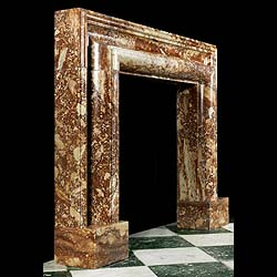 Large bolection fire surround in reddish brescia marble.