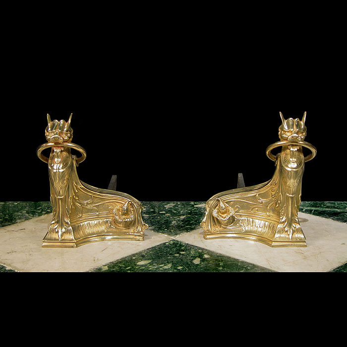 A pair of small bronze Egyptian style Antique Feline Chenets