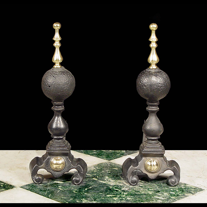 A pair of tall cast iron 20th century Baluster Andirons