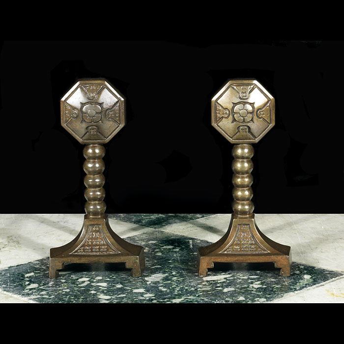 A pair of Arts & Crafts Antique brass Fire Tool Rests