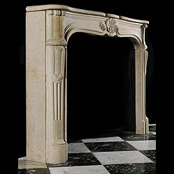 Antique Limestone Rococo Louis XV style French Chimneypiece