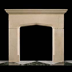 11189: A simple carved limestone Tudor Gothic style fireplace surround with a substantial shelf over a pediment opening. English, 1900.      Link to: Antique Renaissance, Gothic Tudor Fireplace mantels and C