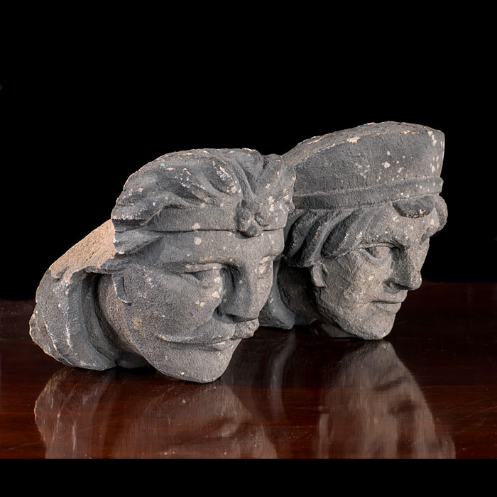 A Tudor style pair of stone figure heads