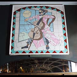 A large mosaic of a musician playing to the moon
