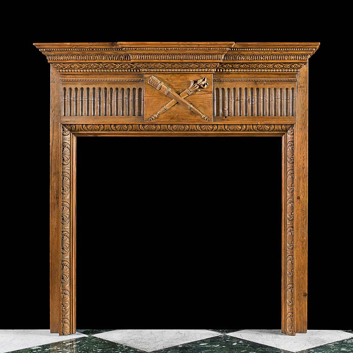 A small carved pine Antique fireplace surround