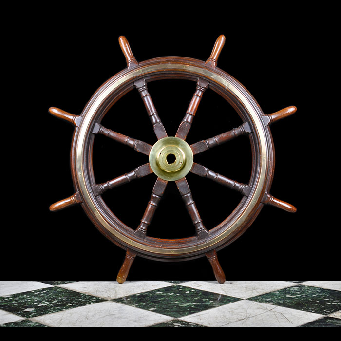 A mahogany ship's wheel