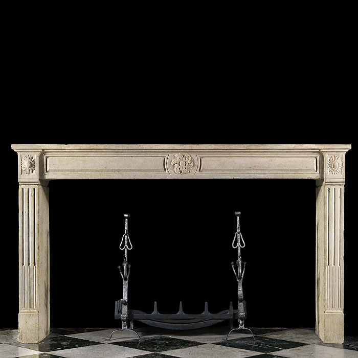 A Louis XVI Wide Limestone Chimneypiece