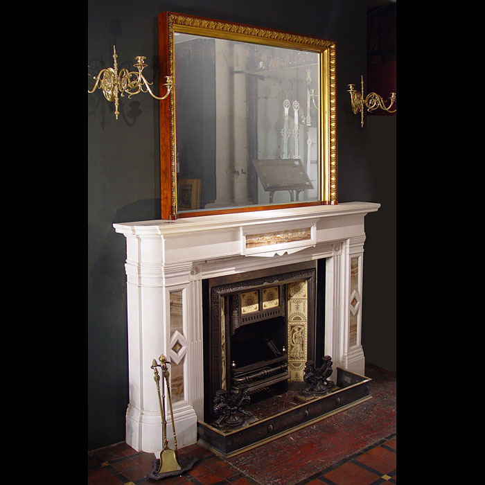 A carved gilded mahogany overmantel mirror