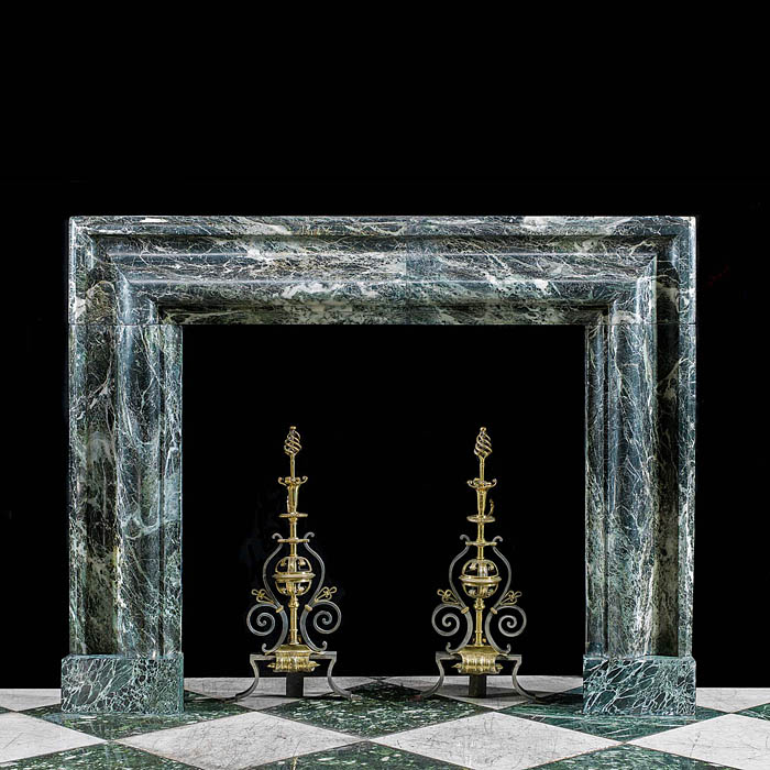 A large antique Verde Tinos Marble Bolection fireplace