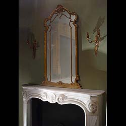 Antique French Rococo Louis XV Wood Frame Mirror  This Overmantel Mirror is in the Louis XV Rococo style with a Gilt wood frame. 19th century.