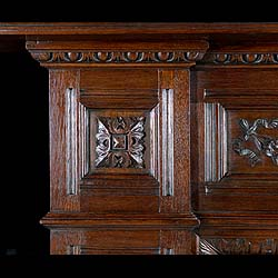 A carved oak antique Jacobean style chimneypiece