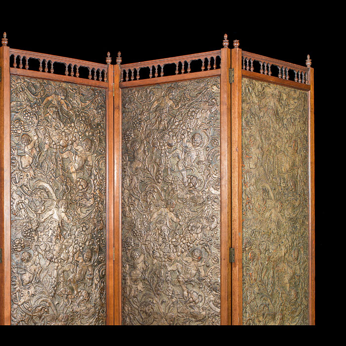 An Arts & Crafts walnut and leather panelled room screen