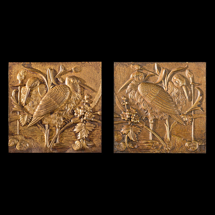 A pair of gilt metal Aesthetic tiles