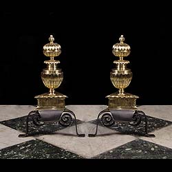 A pair of wrought iron & brass Antique Baroquee style andirons