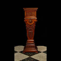 A richly carved antique Victorian walnut pedestal