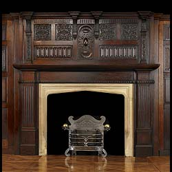 11453: A large Arts and Crafts carved oak chimneypiece and overmantel in the Jacobean Gothic Revival manner, ensuite with the linenfold pannelling SNo 11432. The top breakfront cornice with four projecting p