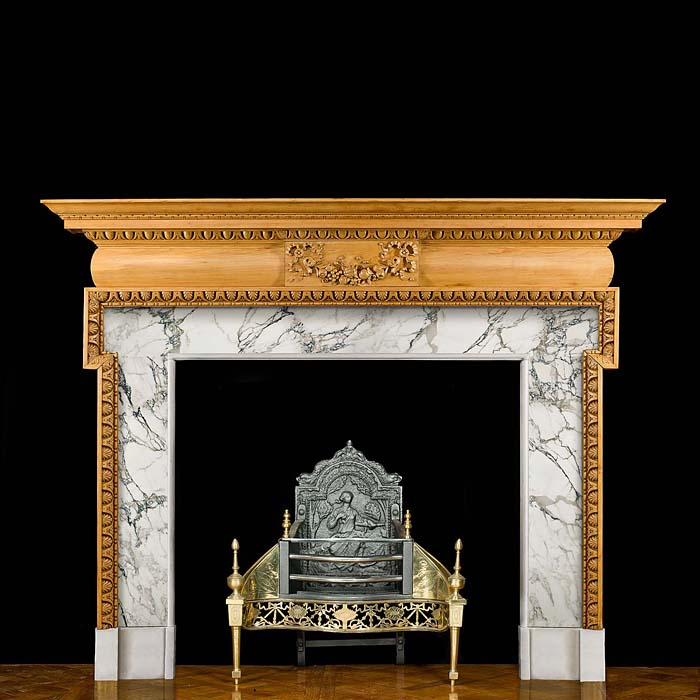 11466: A large period late Georgian pine Fireplace Surround well carved with egg and dart under the plain moulded shelf and around the opening. The frieze centred by a tablet carved with a ribboned fruit swa
