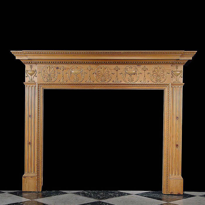 Antique George III style in a Robert Adam manner carved Pine fireplace