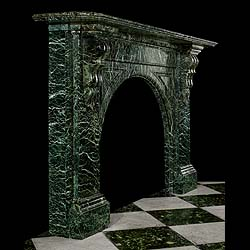 11515: A very handsome large Victorian arched chimneypiece in Verde Antico green veined marble. The deep shaped & moulded shelf above the slow arched opening, with inset spandrels, is supported by scrolled b