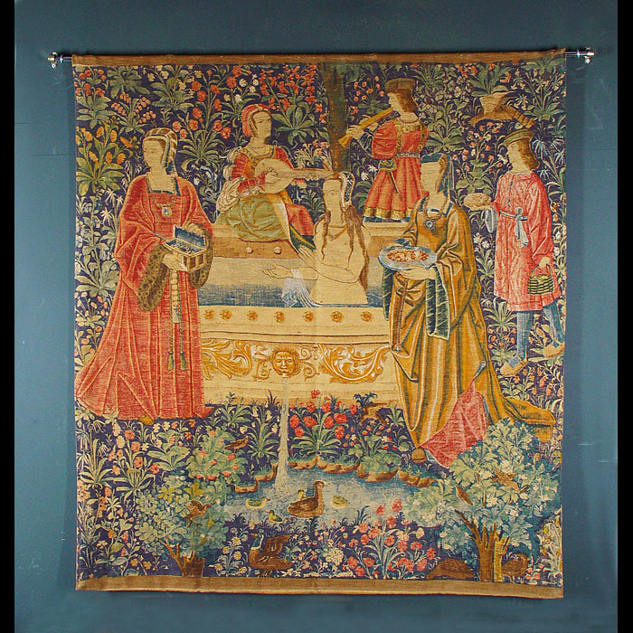 Antique Trio of Medieval Coloured Canvas Tapestries  A set of three colourful Canvas Wall Tapestries in a Medieval manner. Medieval musicians are shown with a naked female, with lion masks. Late 19th century.