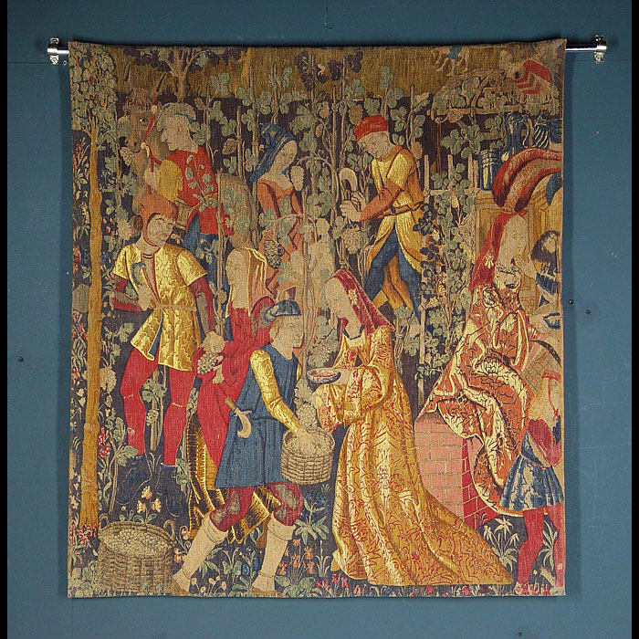 Antique Trio of Medieval Coloured Canvas Tapestries  A set of three colourful Canvas Wall Tapestries in a Medieval manner. Medieval figures are shown picking grapes in a vineyard. Late 19th century.