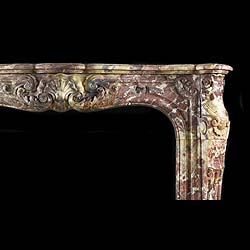 A Rare French Rococo Fior Di Pesco Apuano Marble Fireplace Surround