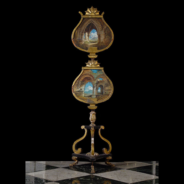 11590: A tall giltwood and polychrome firescreen, the two scallop shaped guards with pastel paintings of a ruined church, on scrolling tripod base and claw feet. English, mid 19th century.  Link to:  Antique