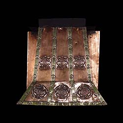 Antique Tudor fire grate with copper House of York roses.