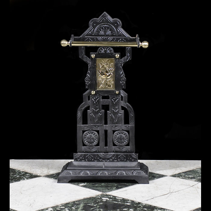 A brass and cast iron stick stand