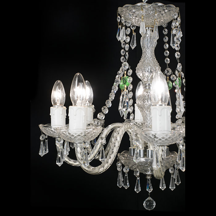 An eight branch 20th century cut and moulded glass chandelier