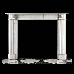 11613: A small elegant Regency style fireplace surround in veined statuary marble, with an understated frieze and jambs topped with intricately carved lions masks. English, 1850.     Link to: Antique English