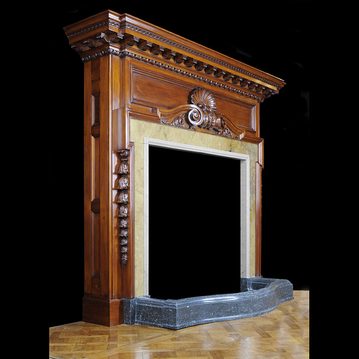 A carved polished pine 1930's English Baroque Chimneypiece