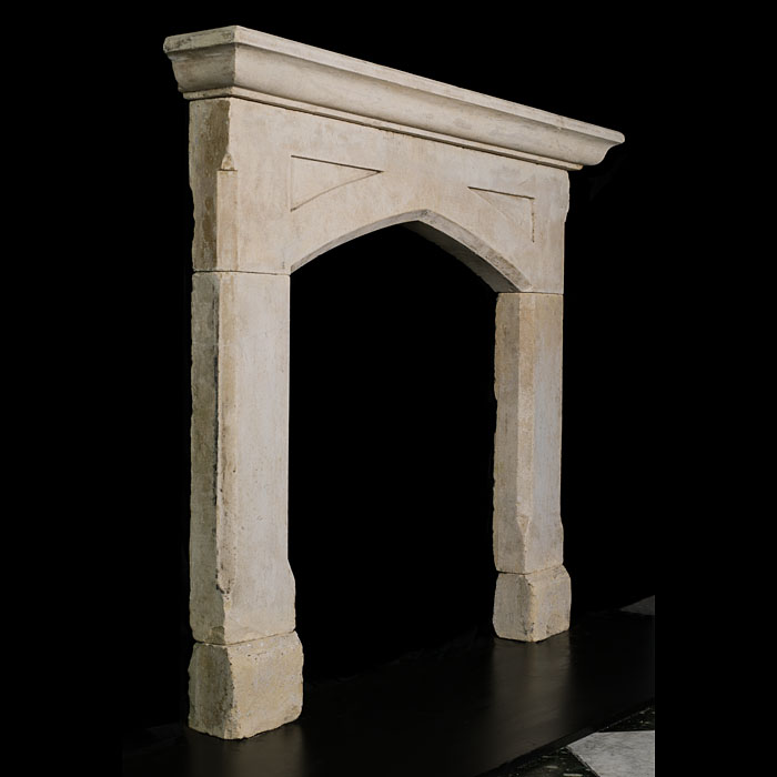 A Gothic Revival antique limestone fireplace surround