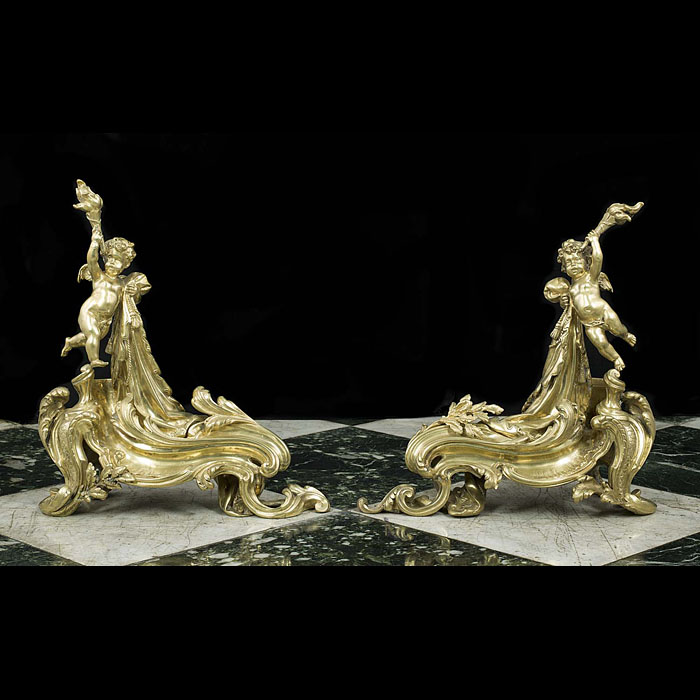 An Antique pair of Rococo style brass Chenets/Fire Dogs