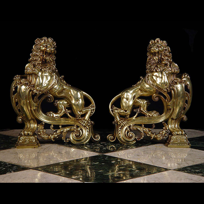 A pair of burnished brass lion antique andirons