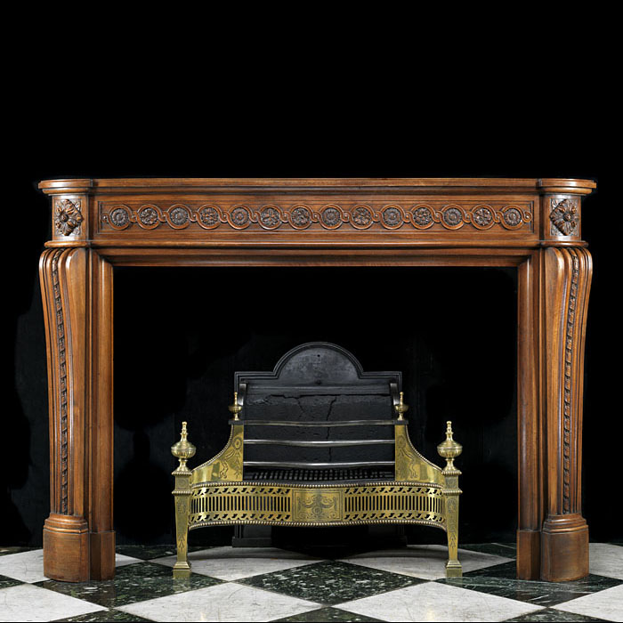 A Louis XVI Carved Walnut Fireplace Mantel